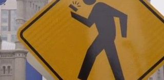 Should Distracted Walking Become Punishable By Law?