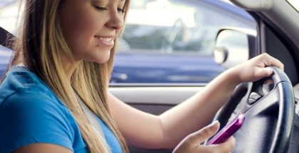 teen girl texting while driving