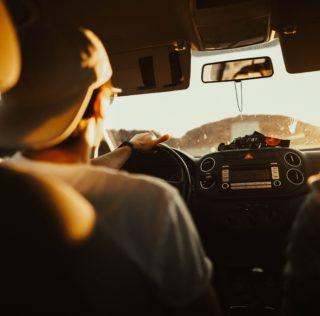 Teenager driving car on freeway